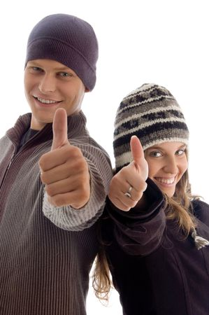 young couple showing thumbs up with white background photo