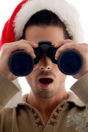 handsome guy looking into binoculars and surprised on an isolated white background photo