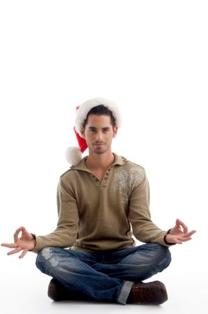 handsome man wearing christmas hat and doing meditation on an isolated white background photo