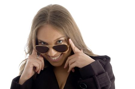 fashion woman peeping over sunglasses on an isolated background photo
