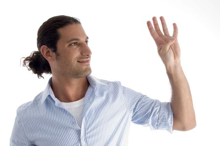 young good looking man with counting fingers against white background Standard-Bild