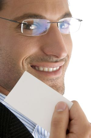 good looking man: close up of young good looking man with business card against white background Stock Photo