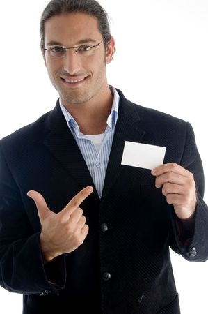 young good looking boss pointing towards business card with white background photo