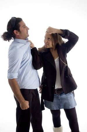 young good looking woman dominating her boyfriend with white background photo