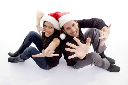 young couple wearing christmas hat with hand gesture on an isolated white background Stock Photo - 3892954