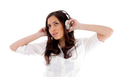 21: young female enjoying music with white background