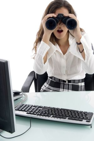 woman in office and looking through binocular with white background photo