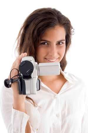 smiling woman holding video camera on an isolated background photo