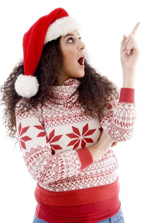 young female with christmas hat indicating upward with white background Stock Photo - 3892700