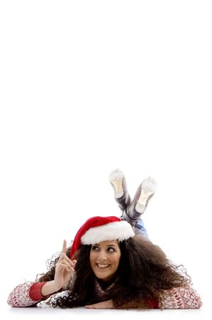 pointing female with christmas hat on an isolated background photo