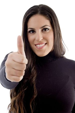 smiling model with thumbs up on an isolated background photo