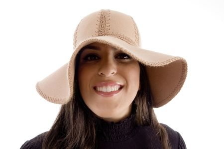 portrait of pretty woman wearing hat on an isolated background photo