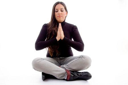 sitting praying young female against white background photo