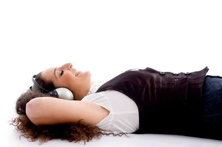 tuned: female tuned into music against white background Stock Photo