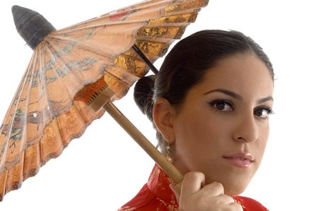 face of female covered with umbrella on an isolated background photo