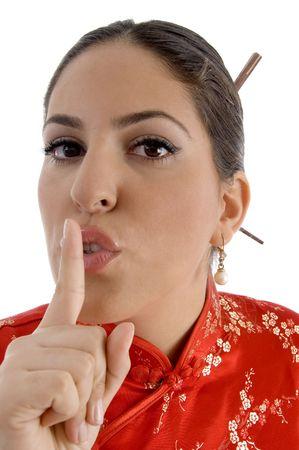 shushing: female showing keep shushing sign with white background Stock Photo