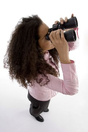 21: smart young businesswoman looking through binoculars on an isolated background