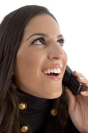 close up of beautiful model talking on phone against white background photo