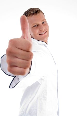 blonde chef wishing goodluck on an isolated white background