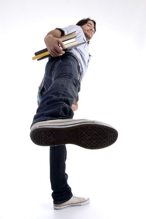 student showing shoe sole on an isolated white background Stock Photo - 3892988