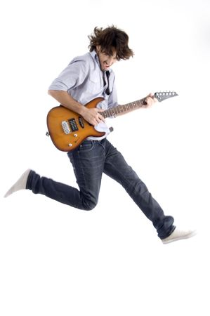 rock star: jumping young male with guitar with white background
