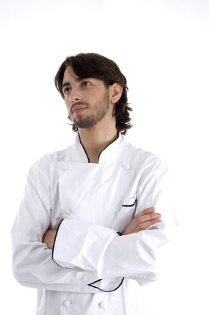 young chef with folded hands on an isolated white background
