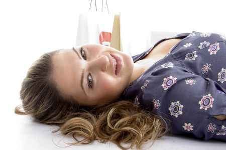26: laying female with bags on an isolated white background