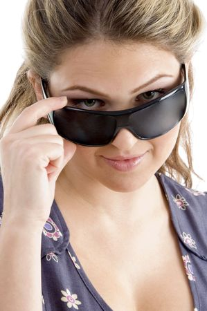 pretty model holding sunglasses on an isolated white background photo
