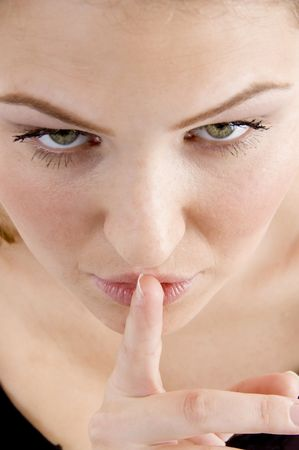 26: high angle view of female asking to keep silent on an isolated white background