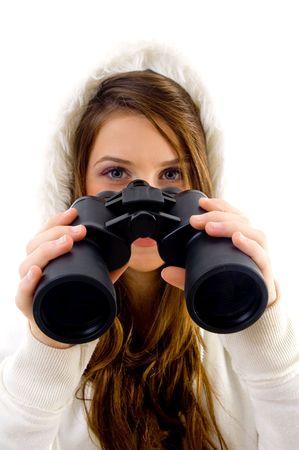 female holding binocular on an isolated white background photo