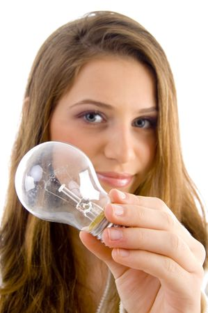 18: beautiful female holding light bulb against white background