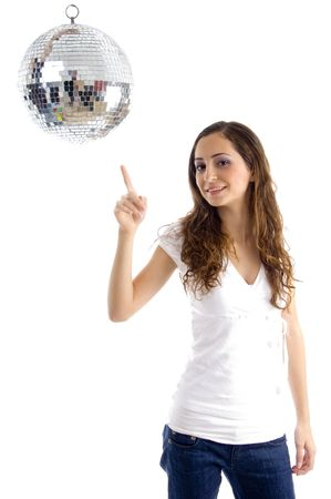 18: beautiful female pointing at mirror ball against white background
