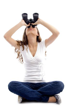 sitting girl looking through binocular against white background