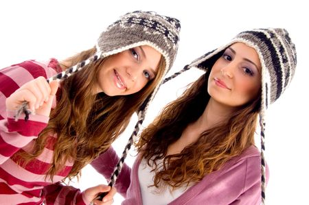 lady s: pretty girls wearing cap and looking at camera against white background