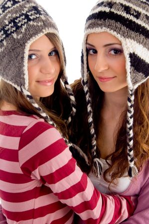 two young friends wearing woolen cap and looking at camera on an isolated white background photo