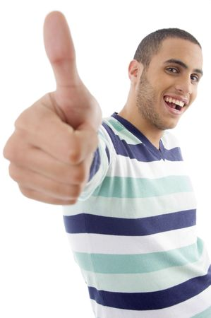 young boy showing thumbs up on an isolated white background Stock Photo