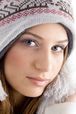 attractive face of female wearing cap with white background photo