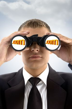 eyeing: young successful professional man eyeing on internet text with binoculars