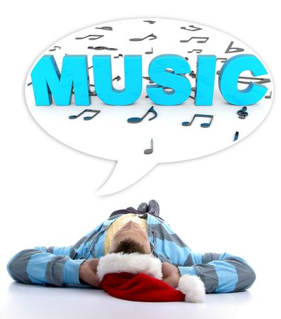 laying man with christmas hat looking at three dimensional musical notes and music text  photo