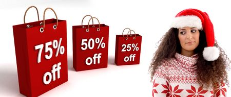 woman wearing christmas hat posing with three dimensional shopping bag  photo