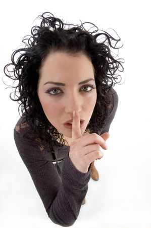 shushing: female asking to keep silent on an isolated background