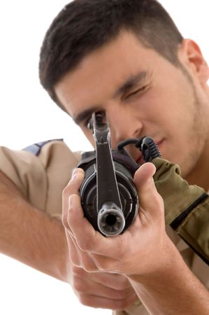 bullet camera: young soldier aiming on an isolated background Stock Photo