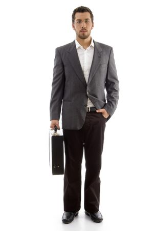 handsome businessman standing with his office bag on an isolated white background photo