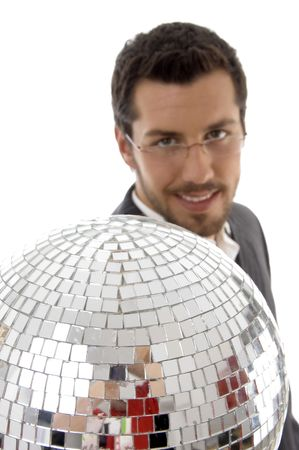 smiling male showing mirror ball against white background photo