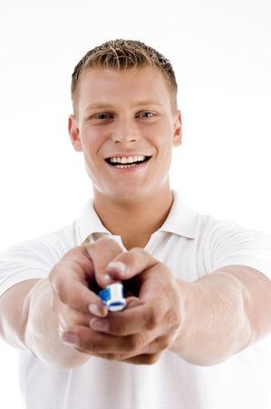smiling male showing tooth brush against white background photo