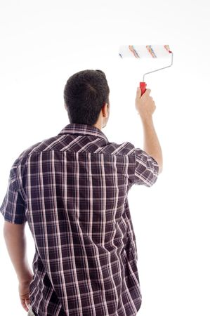 back pose of male using roller brush on an isolated white background photo