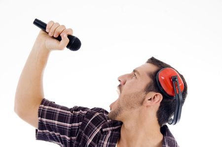 male singing loudly on microphone on an isolated white background photo