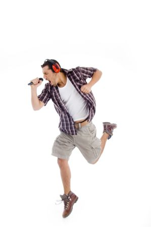 loudly: singer singing loudly in to microphone on an isolated background Stock Photo
