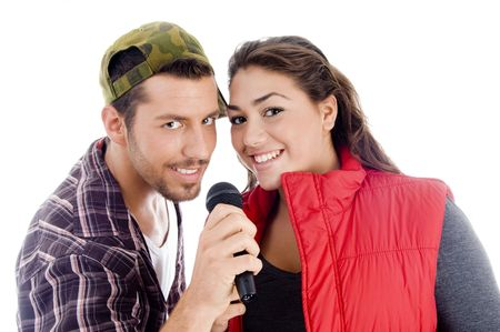 young male and female singer with microphone on an isolated background photo