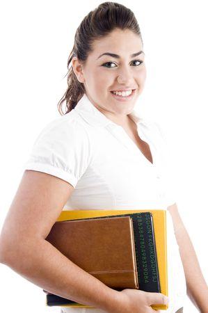 side pose: plantean de cara feliz estudiante con libros sobre un fondo blanco aisladas